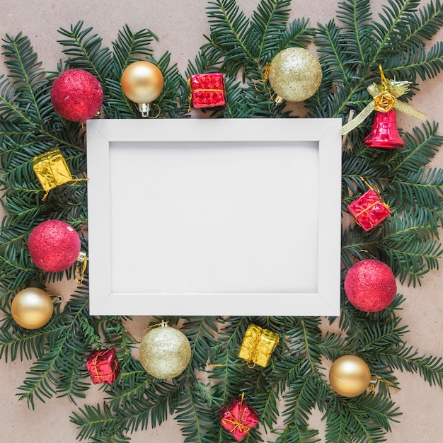 Photo frame on fir twigs with christmas balls Free Photo