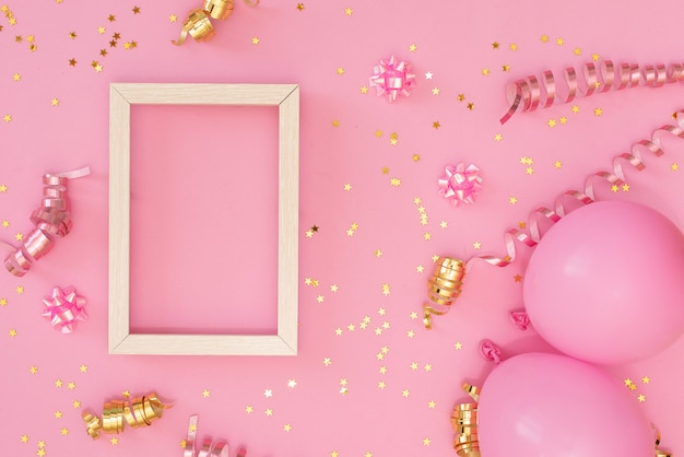 Photo frame mock up with space for text, golden confetti on white background. Premium Photo