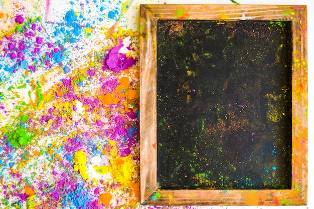 Photo frame near blurs and heaps of different bright dry colors Free Photo