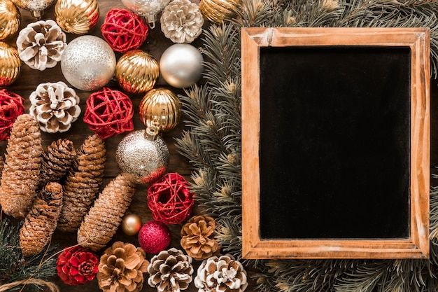 Photo frame near fir twigs and christmas toys Free Photo