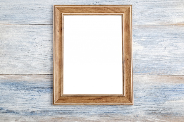 Photo frame on wooden background - vintage style effect picture Premium Photo