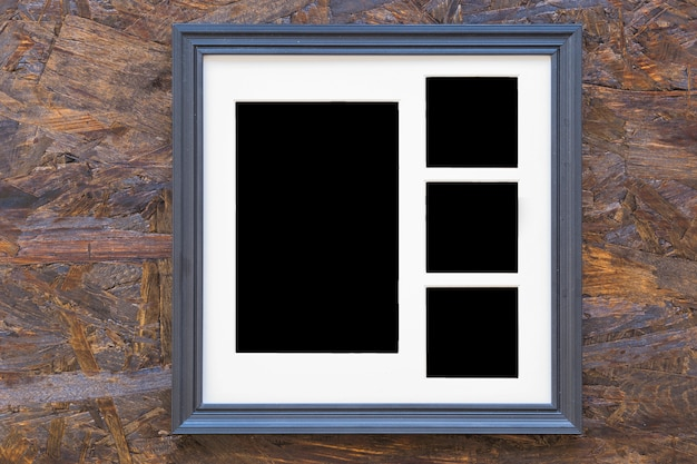 Photo frame on wooden textured background Free Photo