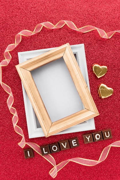 Photo Frames Near Ornament Hearts Ribbon And I Love You Inscription