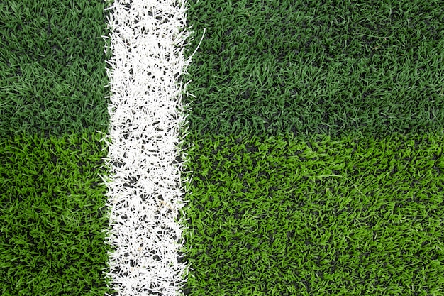 Photo of a green synthetic grass sports field with white line shot Premium Photo