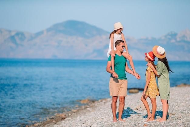 Photo of happy family having fun on the beach. summer lifestyle Premium Photo