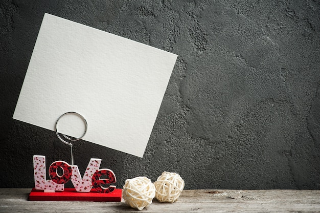 Photo holder with word love Premium Photo