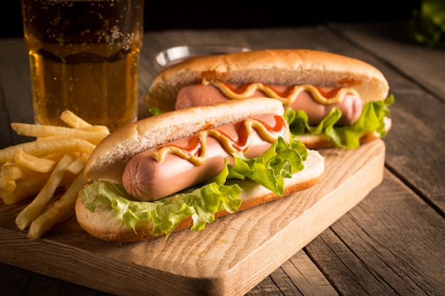 Photo of  hot dog with yellow mustard and ketchup. Premium Photo