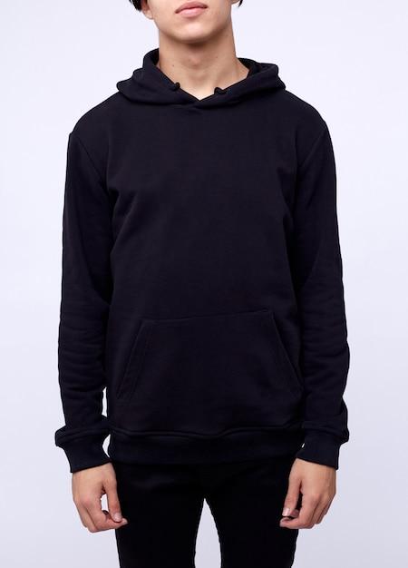 Photo of man wearing black hoodie isolated on white Premium Photo