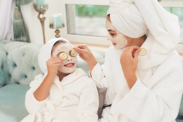 Photo of mother and daughter in white bathrobes Premium Photo