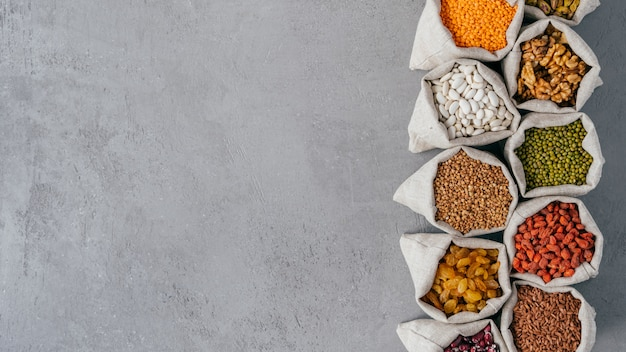 Photo of nutritious organic products in sacks with various beans. Premium Photo