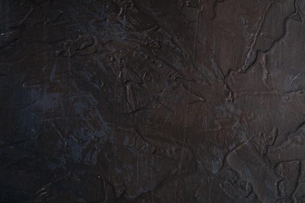 黒、茶色、青のグランジ色、ペイント、スプラッシュドロップの背景で創造的な暗いテクスチャサーフェスの写真 Premium写真