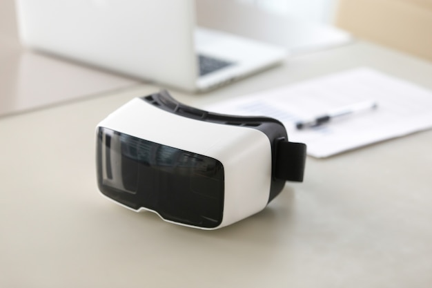 Photo of virtual reality glasses on office table Free Photo