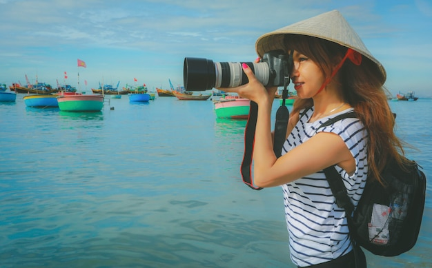 Photographer asian woman taking photos with camera professional ...