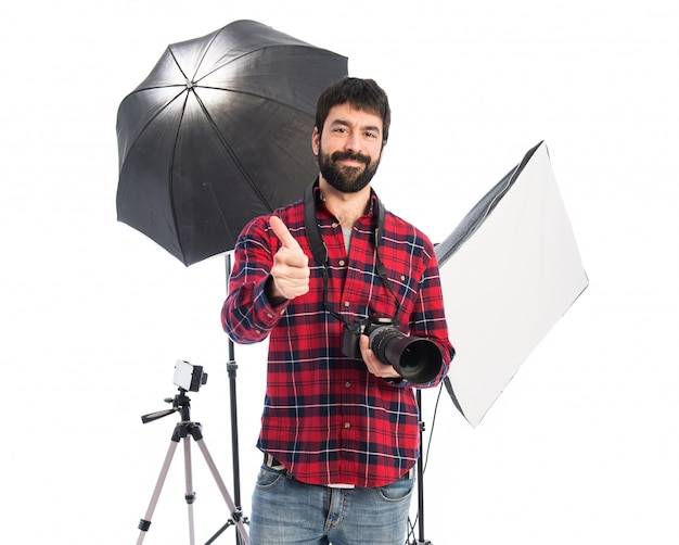 Photographer in his studio with thumb up Free Photo