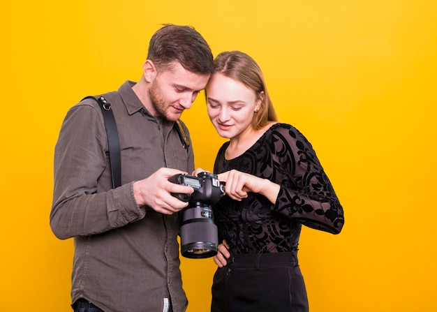 Photographer and model checking pictures on camera Free Photo