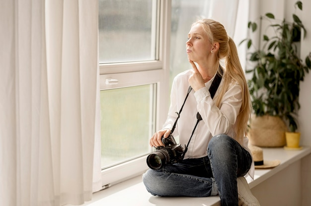 What is Macro Photography? 1. Shoot by a Window When Indoors (Photographer sitting on window sill photo art concept Free Photo)