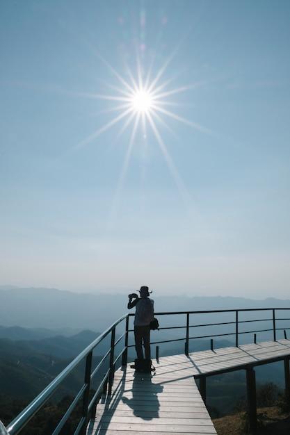 Photographer under sun in daylight Free Photo