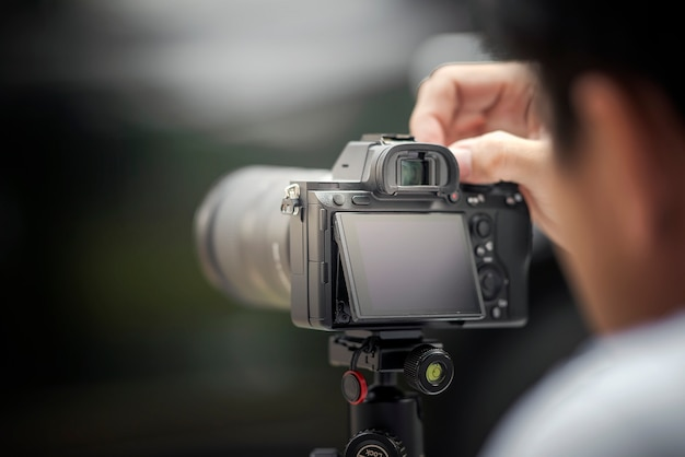 The photographer taking a photo with digital camera Premium Photo