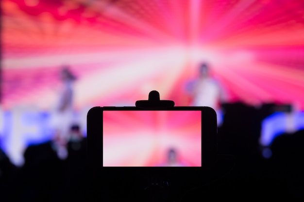 Photographing with smartphone in concert Premium Photo