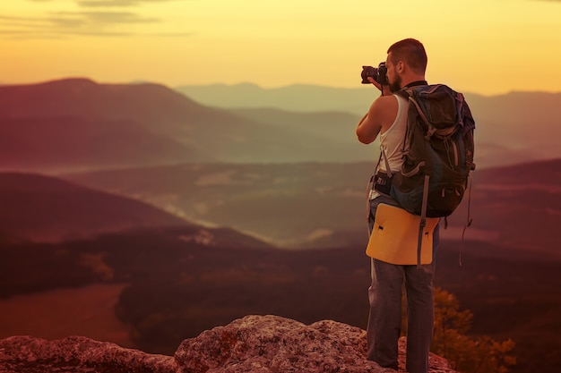 Photography man  in mountain Premium Photo