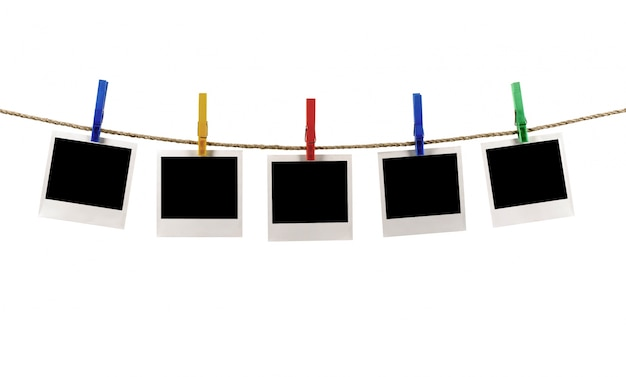Photos on a rope with clothespins Free Photo