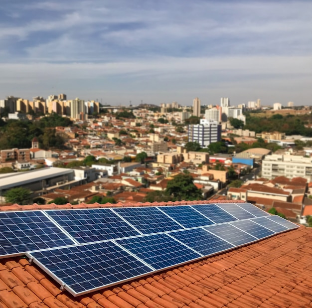 Photovoltaic power plant on the roof of a residential building on sunny day - solar energy concept of sustainable resources Premium Photo