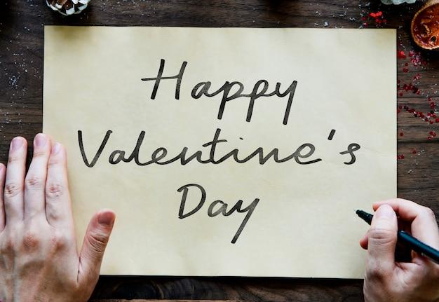 Phrase happy valentine's day on a paper Free Photo