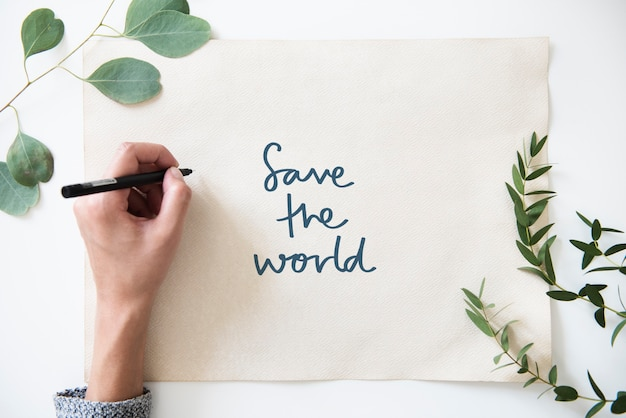 Phrase save the world in plant decoration Premium Photo