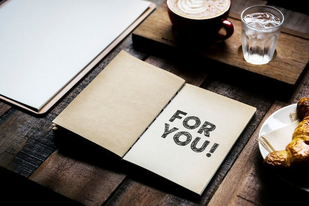 Phrase for you on a notebook Premium Photo