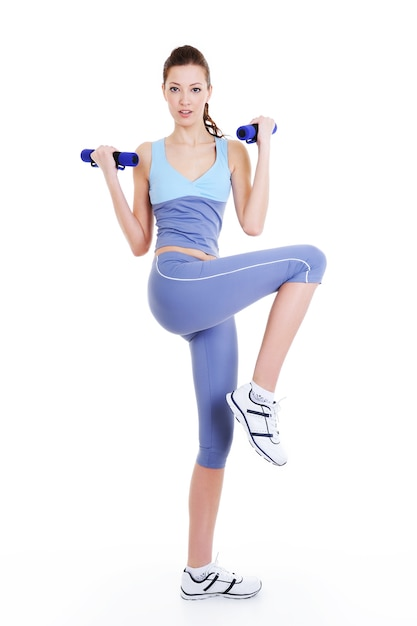 Physical training exercise of young beautiful woman with dumbbells Free Photo