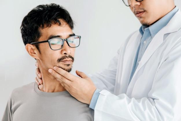 Physiotherapist doing healing treatment on man's neck, chiropractic adjustment Premium Photo