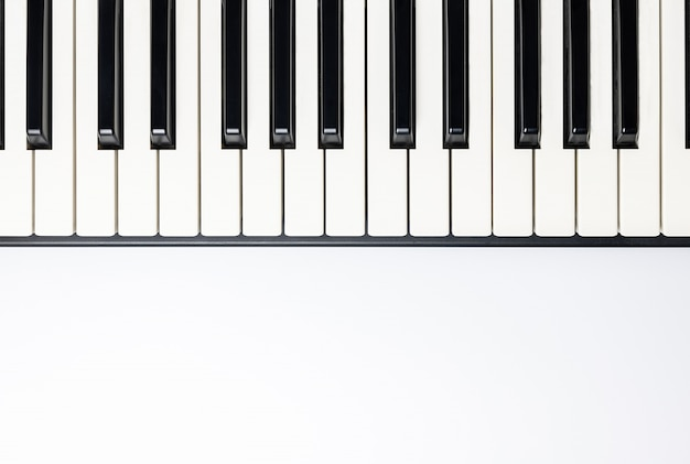 Piano keys with copy space, isolated for design, top view, flat lay. Premium Photo