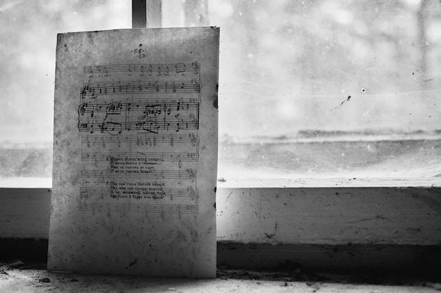 Piano notes on an old paper near a window Free Photo