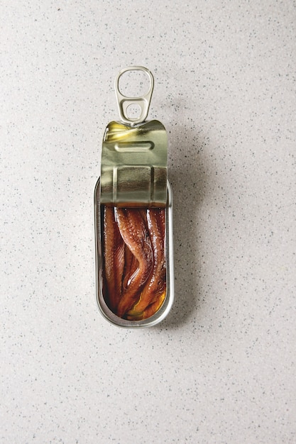 Pickled anchovies in tin can Premium Photo