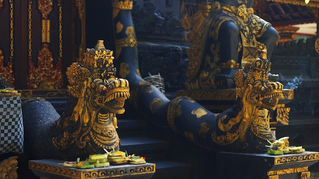 Picture of balinese temple gate guardian statue Premium Photo