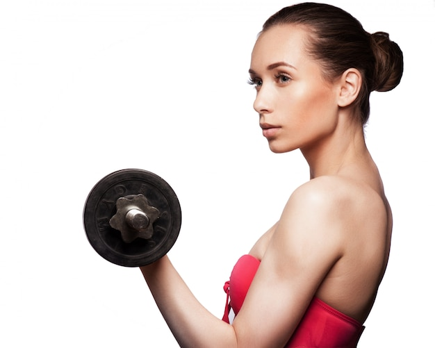 Picture of beautiful sporty woman with dumbbell Premium Photo