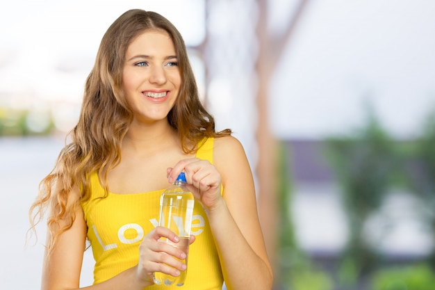 Picture of beautiful woman with bottle of water Premium Photo