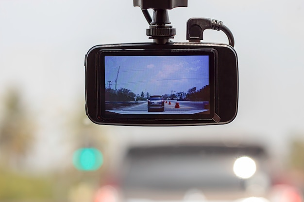 Picture cars and sky on camera in car. Premium Photo