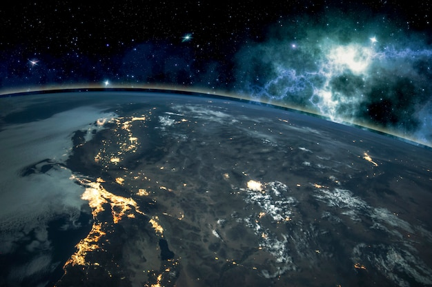 Picture of earth in space, stars all around, night sky. elements of this image furnished Premium Photo
