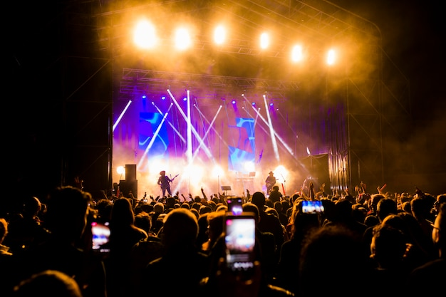 Picture of a lot of people enjoying night perfomance Premium Photo