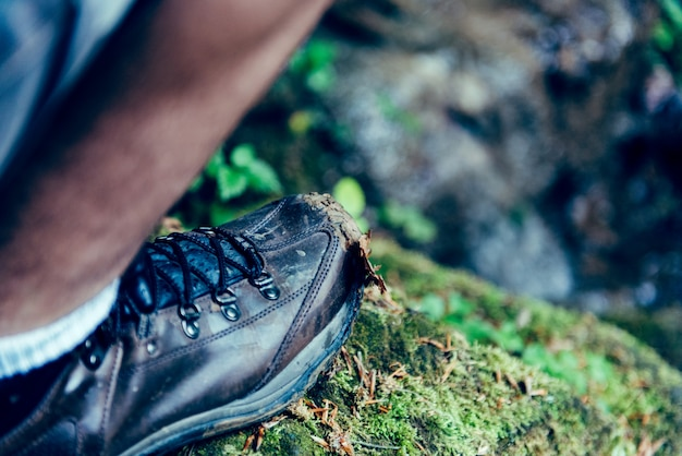 Picture of man shoes standing on the rock Premium Photo