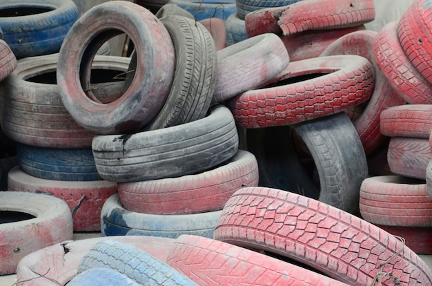 A picture of many old used tires left on a waste dump Premium Photo