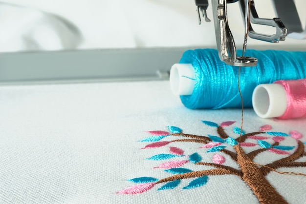 Picture of works pace in the embroidery machine close up look under the needle