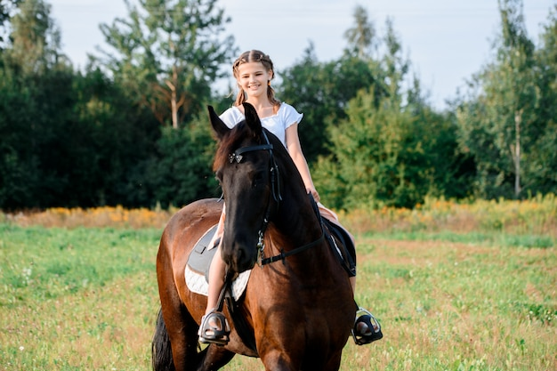 Picture of young pretty girl riding horse Premium Photo