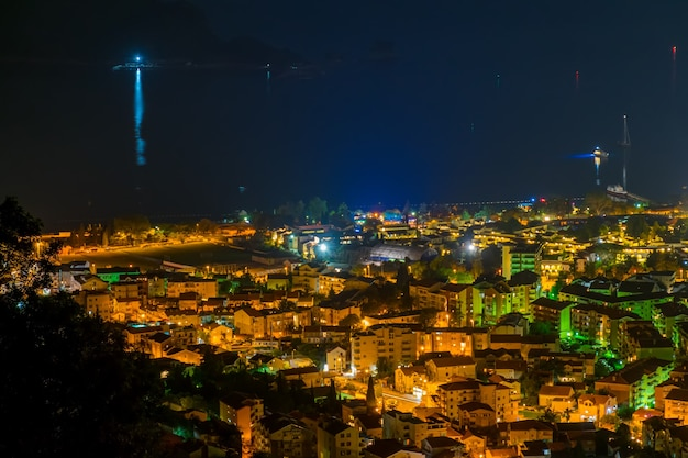 A picturesque panorama of the night city from the top of the mountain. Premium Photo