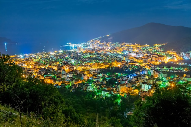 A picturesque panorama of the night city from the top of the mountain Premium Photo