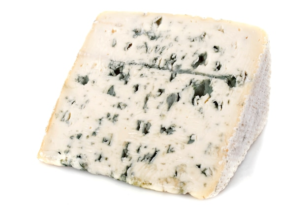 Piece of blue cheese on white Premium Photo