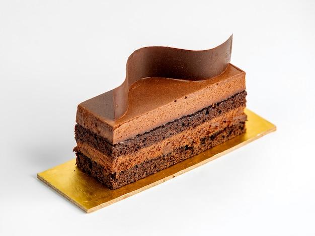 Pezzo di torta con caramello e cioccolato Foto Gratuite