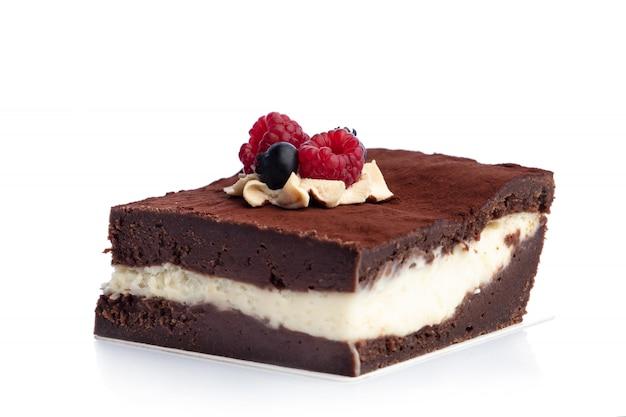 Piece of chocolate cake isolated on white background. Premium Photo