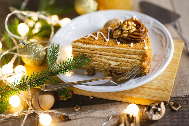 A piece of christmas cake on the wooden table Premium Photo
